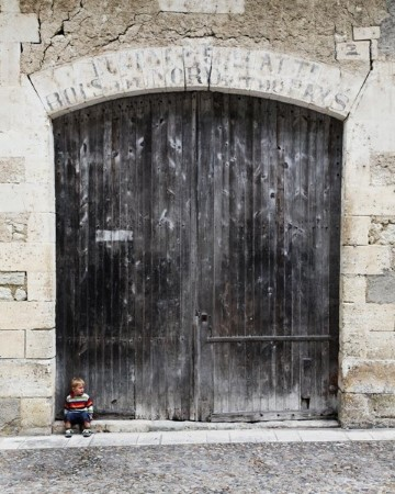 Aubeterre - child in doorway, Holiday in Charente, South west France